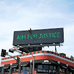 Aim for Justice billboard