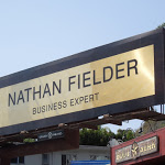 Nathan Fielder Business Expert name plate billboard