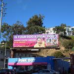 Canine plastic surgery parody billboard